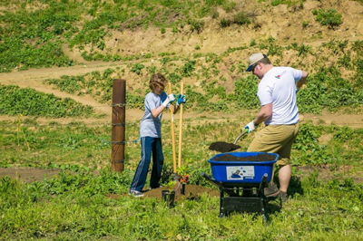 Two volunteers plant a tree at the Rancho Ventura Conservation