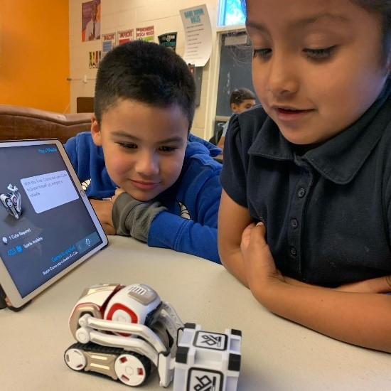 Photo of children at Boys & Girls Club event looking at robotics