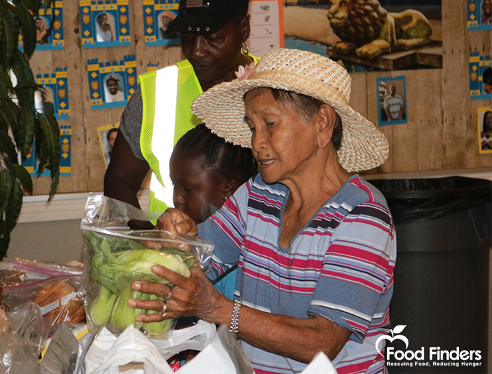 Photo of people receiving food from Food Finders event