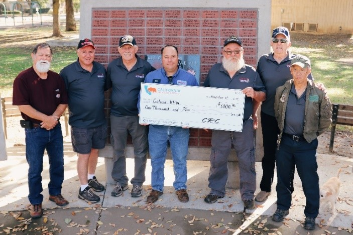 Photo of Veterans of Colusa county holding a large CRC check